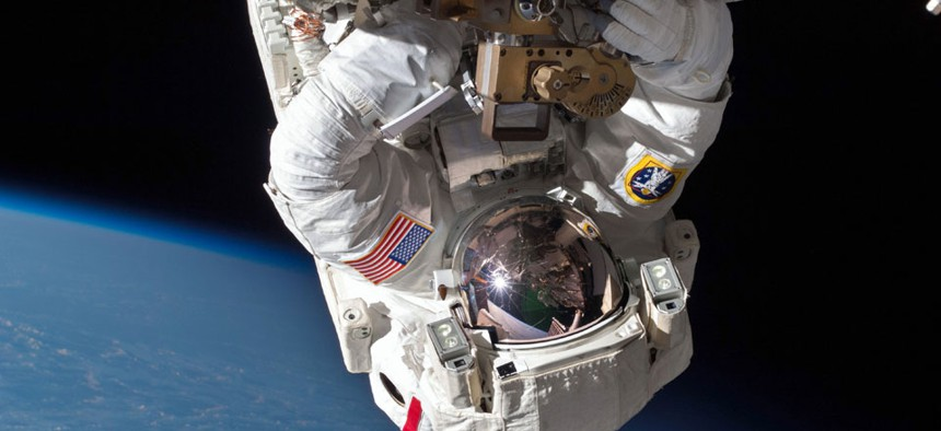 Astronaut Chris Cassidy performs a space walk on the International Space Station.