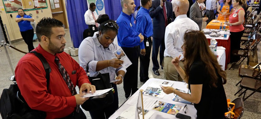 Job seekers check out the job opportunities at a Hiring Fair For Veterans in Fort Lauderdale, Fla.
