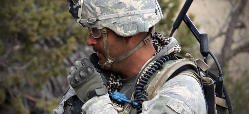 A Soldier from 2nd Brigade, 1st Armored Division, uses a Joint Tactical Radio System's Handheld, Manpack and Small Form Fit, known as JTRS HMS, at the Army's Network Integration Evaluation, or NIE 13.1, on Nov. 9, 2012.