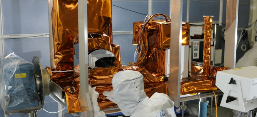 The Ozone Mapping and Profiler Suite (OMPS) instrument, part of the JPSS satellite system, undergoes post thermal inspection at a Ball facility in Boulder, Colo.