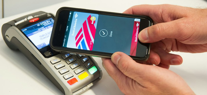 MasterCard demonstrates Apple Pay at the launch of MasterCard's NYC Tech Hub on Monday, Oct. 20, 2014.