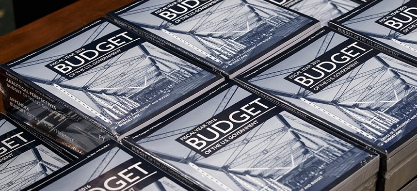 President Barack Obama's new $4 trillion budget plan is distributed by Senate Budget Committee staffer Eric Chalmers as it arrives on Capitol Hill in Washington, early Monday, Feb. 2, 2015.