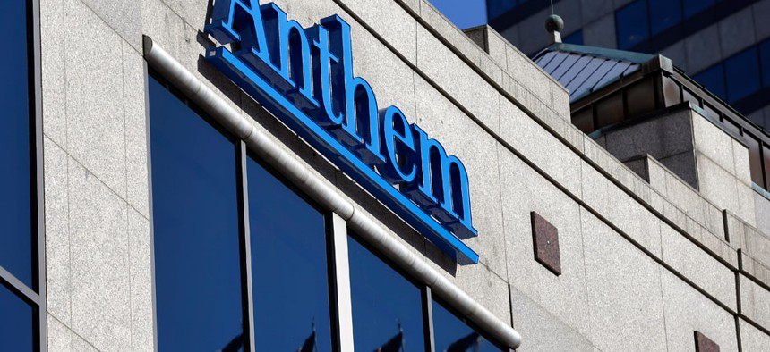 The Anthem logo hangs at the health insurer's corporate headquarters in Indianapolis.