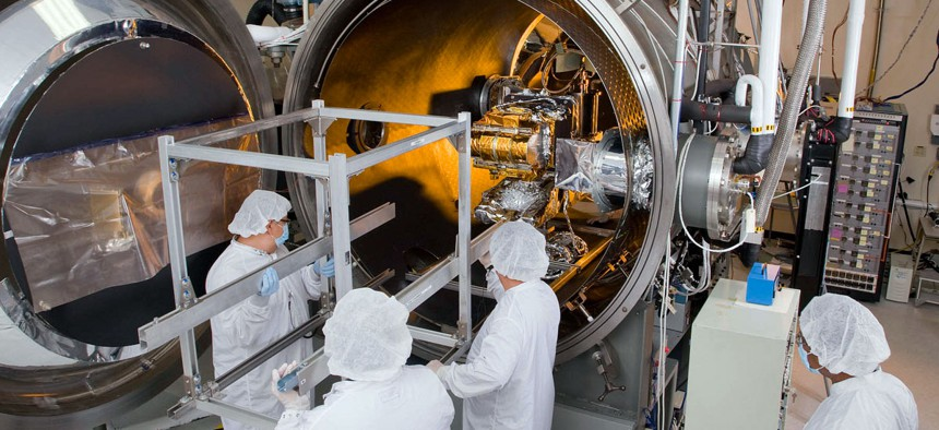 Engineers work on the CERES Instrument which will be integrated onto the Joint Polar Satellite System spacecraft, scheduled for launch in early 2017.