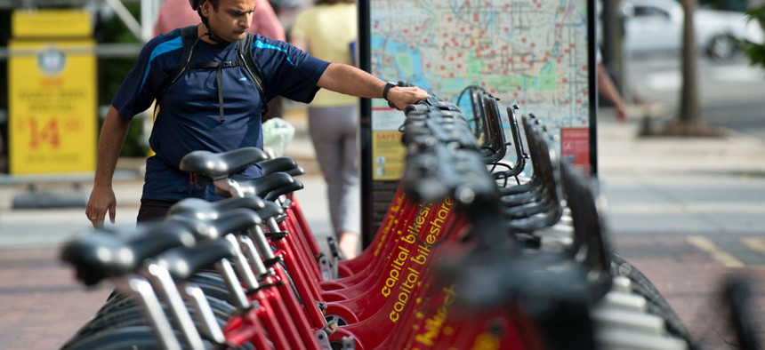 A rider picks out a bike at a Capital Bikeshare station in Washington, DC.