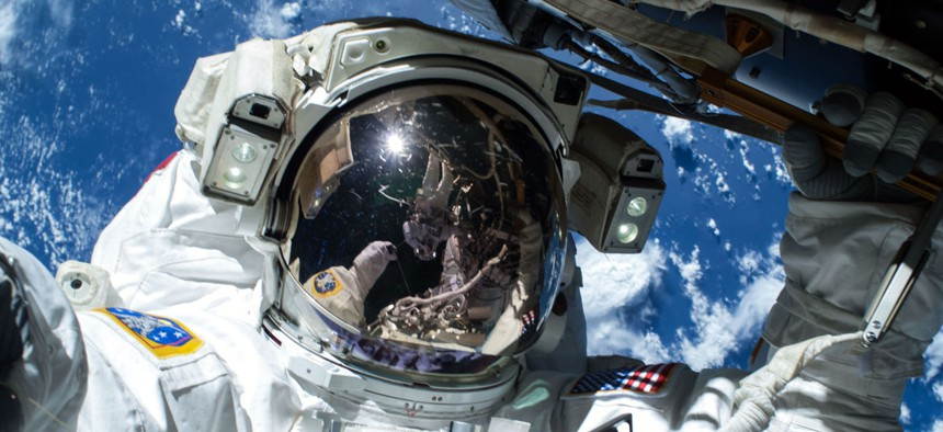 NASA astronaut Barry Wilmore works outside the International Space Station on the first of three spacewalks preparing the station for future arrivals by U.S. commercial crew spacecraft, Saturday, Feb. 21, 2015.