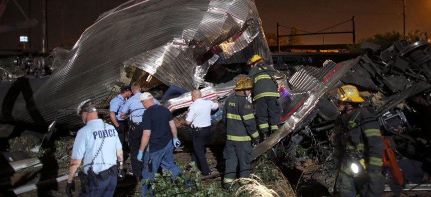Emergency personnel work at the scene of the Amtrak train wreck, Tuesday, May 12, 2015, in Philadelphia.