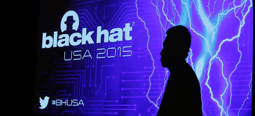The shadow of an attendee is cast on a screen during the Black Hat conference Thursday, Aug. 6, 2015, in Las Vegas.