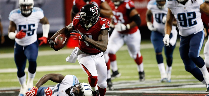 Atlanta Falcons wide receiver Julio Jones (11) runs against Tennessee Titans strong safety Bernard Pollard (31) during the first half of an NFL preseason football game in Atlanta.