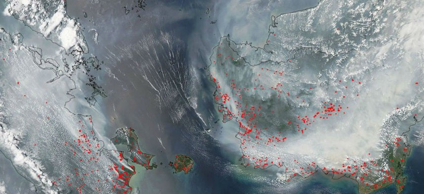 That's Borneo on the right, under all that smoke. Sumatra is on the left.