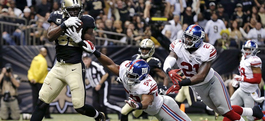New Orleans Saints tight end Benjamin Watson (82) pulls in a touchdown pass in in front of New York Giants free safety Landon Collins (21) and outside linebacker Devon Kennard (59) the second half of an NFL football game.