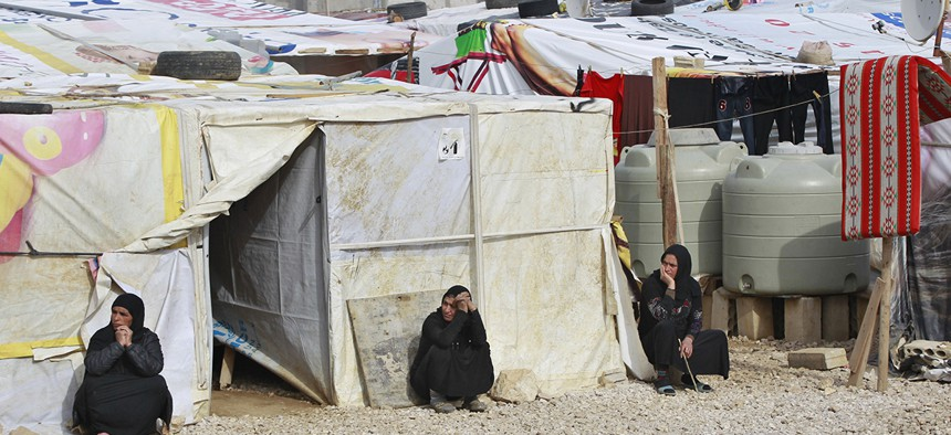 Syrian refugees women sitting outside their tents, during the visit of Filippo Grandi, the United Nations High Commissioner for Refugees, UNHCR, to a camp in the town of Saadnayel, in the Bekaa valley, Lebanon, Friday, Jan. 22, 2016.