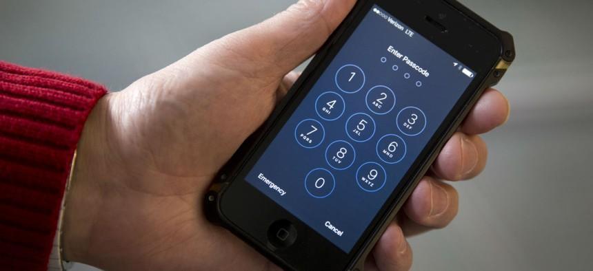 An iPhone is seen in Washington, Wednesday, Feb. 17, 2016.