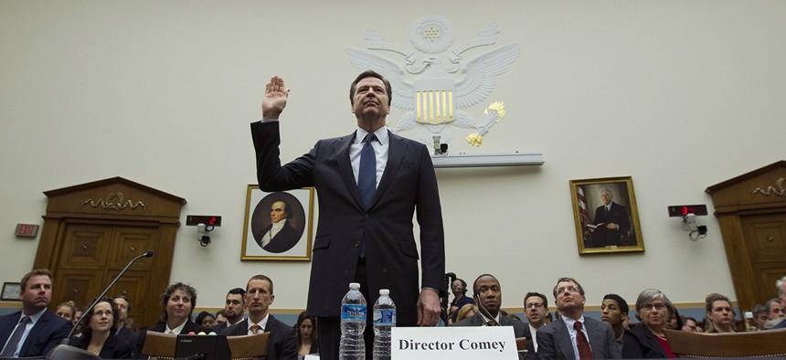 FBI Director James Comey testifies on Capitol Hill in Washington.