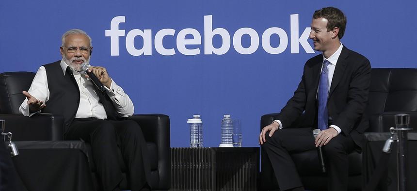 Prime Minister of India Narendra Modi, left, speaks next to Facebook CEO Mark Zuckerberg at Facebook in Menlo Park, Calif., Sunday, Sept. 27, 2015.