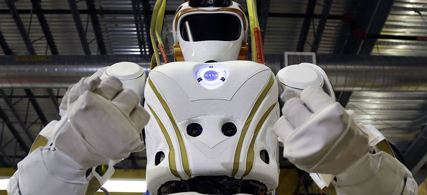 A six-foot-tall, 300-pound Valkyrie robot is seen at University of Massachusetts-Lowell's robotics center in Lowell, Mass.