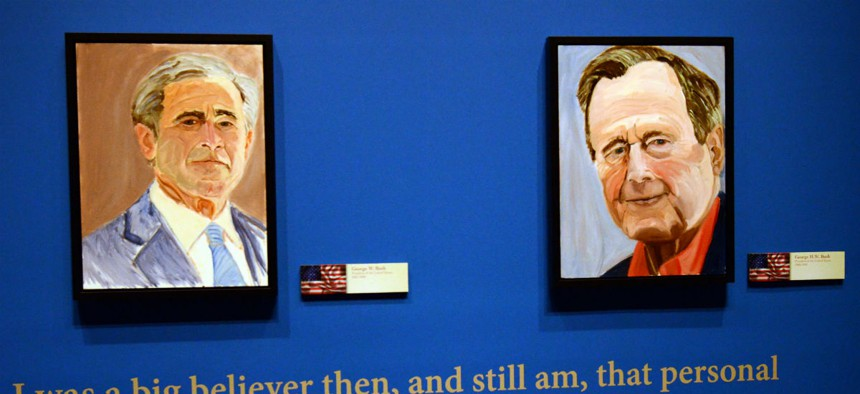 """Portraits of former Presidents George W. Bush, left, and his father, George H.W. Bush, both painted by George W. Bush, are on display as part of """"The Art of Leadership: A President's Diplomacy"""" exhibit."""
