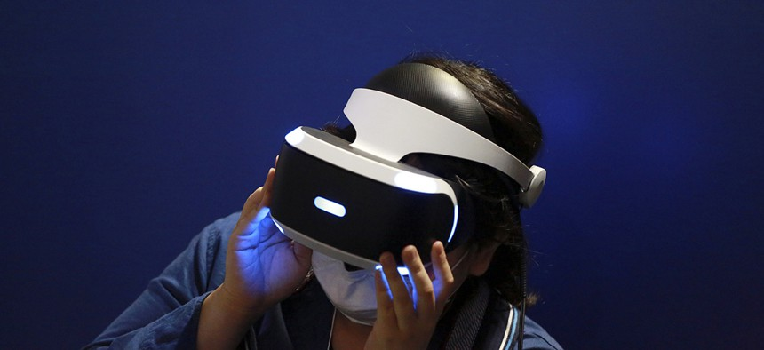 A visitor tries out a Sony's PlayStation VR headgear device at the Tokyo Game Show in Makuhari, near Tokyo.
