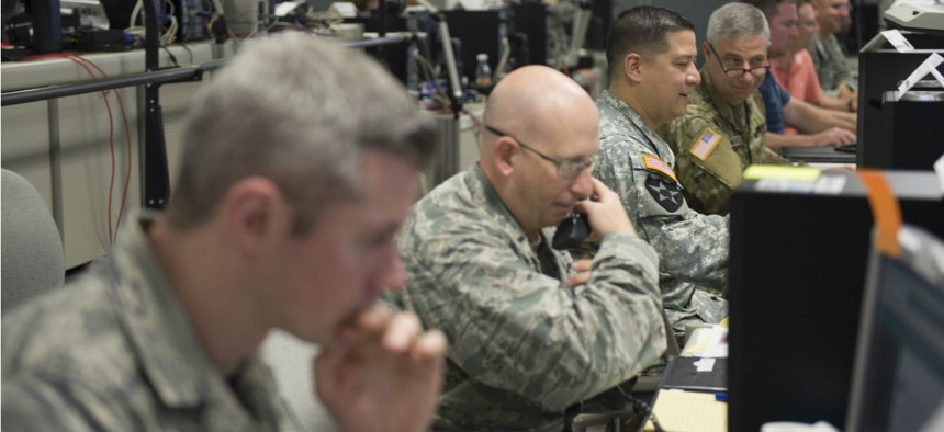 Participants at Cyber Guard 2016 works through a training scenario during the nine-day exercise Suffolk, Va.