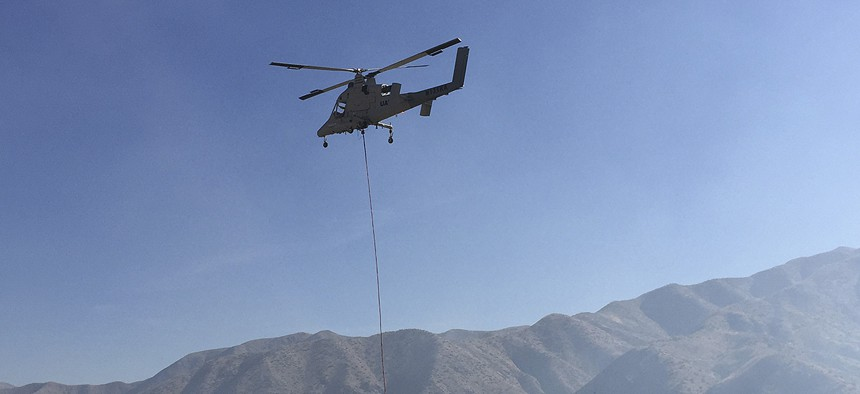 A remote-controlled Lockheed Martin K-MAX helicopter takes off Wednesday, Oct. 14, 2015, from the U.S. Forest Service's Lucky Peak Helibase about 20 miles east of Boise, Idaho.