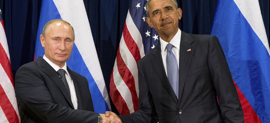 U.S. President Barack Obama, right, and Russia's President President Vladimir Putin pose for members of the media before a bilateral meeting at the United Nations headquarters in 2015.