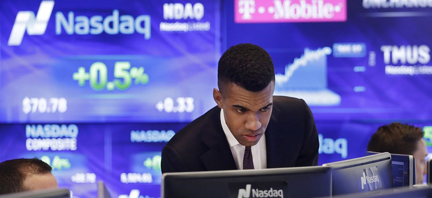 Brad Smith monitors stock prices at the Nasdaq MarketSite, Tuesday, April 25, 2017, in New York.