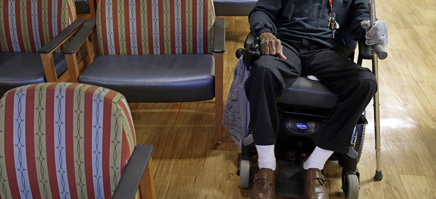 A U.S. Army veteran waits for prescription drugs in a pharmacy waiting room inside the Fayetteville Veterans Affairs Medical Center in Fayetteville, N.C.