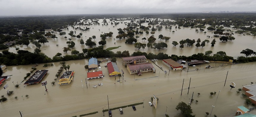 In this aerial photo, businesses and neighborhoods near Addicks Reservoir are flooded by rain from Tropical Storm Harvey Tuesday, Aug. 29, 2017, in Houston.