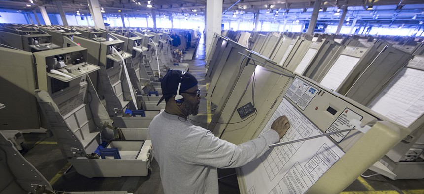 A technician works to prepare voting machines to be used in the upcoming 2016 election in Philadelphia.