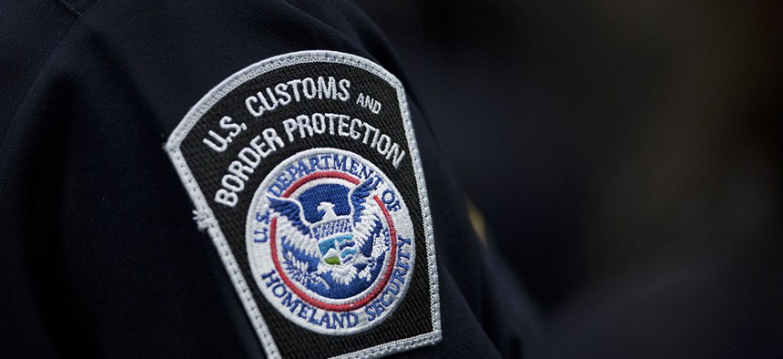 A customs agent wears a patch for the U.S. Customs and Border Protection agency.