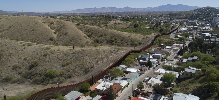 This photo made with a drone, shows the U.S. Mexico border fence as it cuts through the two downtowns of Nogales, Ariz.