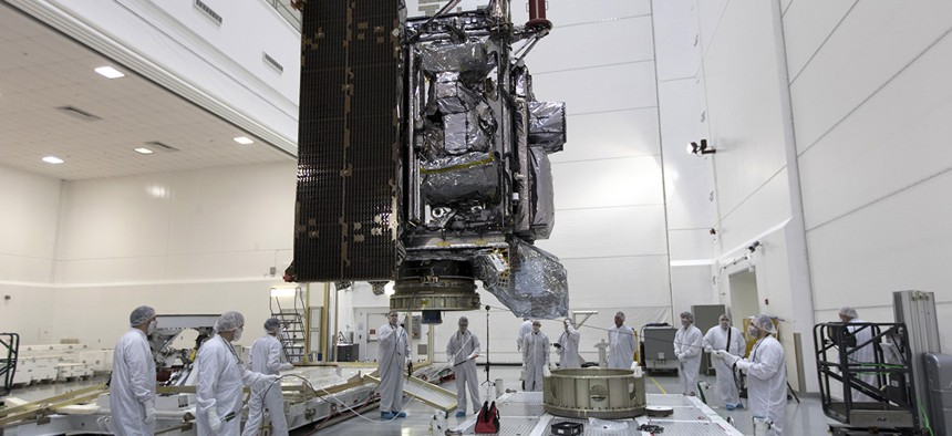 Technicians and engineers move NOAA's Geostationary Operational Environmental Satellite-S (GOES-S) to a work stand at Astrotech Space Operations in Titusville, Fla.