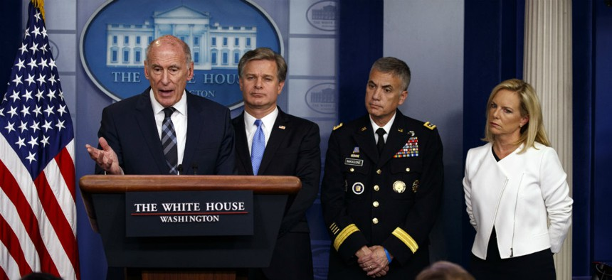 ODNI Dan Coats speaks during the daily press briefing at the White House Aug. 2, as FBI Director Christopher Wray, NSA Director Gen. Paul Nakasone, and Homeland Security Secretary Kirstjen Nielsen listen.
