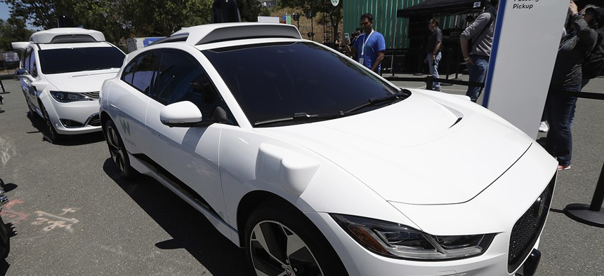Waymo cars are displayed at the Google I/O conference in Mountain View, Calif., Tuesday, May 8, 2018.