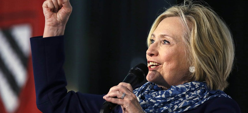 Hillary Clinton pumps her fist as she is introduced at Harvard University in Cambridge, Mass., Friday, May 25, 2018.