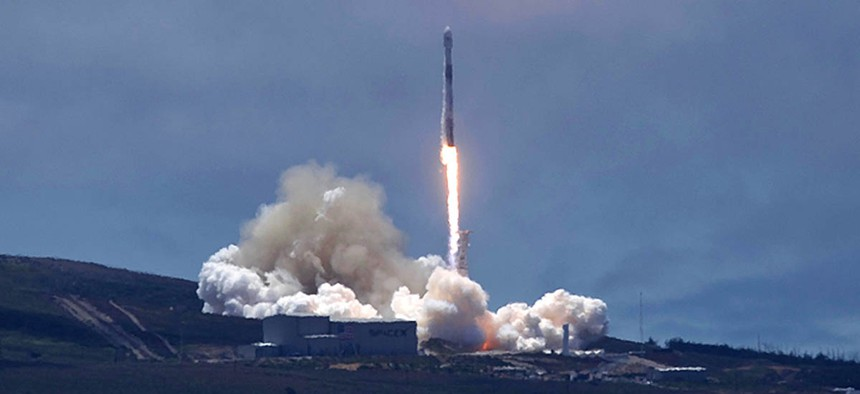 A SpaceX Falcon 9 rocket carrying two U.S.-German science satellites and five commercial communications satellites blasts off from Vandenberg Air Force base.