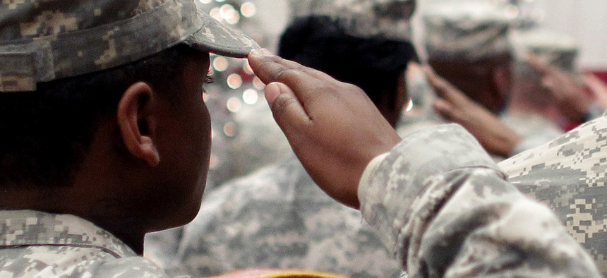 Soldiers salute the U.S. flag during the Pledge of Allegiance at a welcome home ceremony for soldiers returning from a deployment in Afghanistan, at Fort. Carson, Colo.