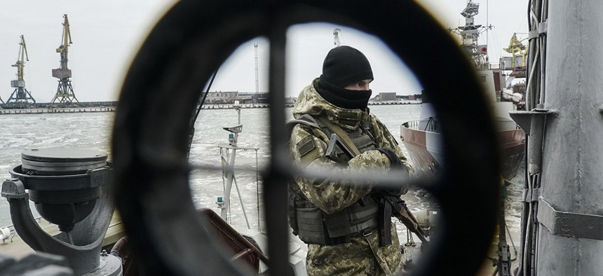 A Ukrainian serviceman stands on board a coast guard ship in the Sea of Azov port of Mariupol, eastern Ukraine, Monday, Dec. 3, 2018.