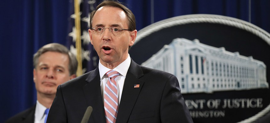 Deputy Attorney General Rod Rosenstein with FBI Director Christopher Wray, speaks during a news conference at the Justice Department in Washington, Thursday, Dec. 20, 2018