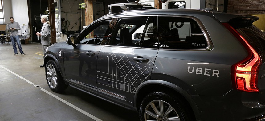 An Uber driverless car is displayed in a garage in San Francisco.