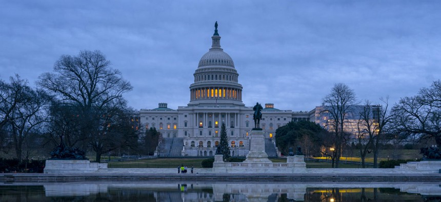 The Capitol is seen under early morning skies in Washington, Thursday, Dec. 20, 2018.