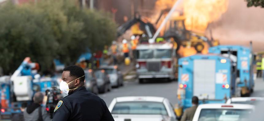 Firefighters battle a gas main blaze on Geary Blvd in San Francisco's Richmond District in February.
