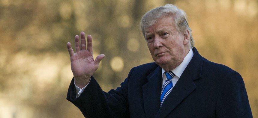 President Donald Trump waves as he walks on the South Lawn after stepping off Marine One at the White House, Sunday, March 10, 2019, in Washington.