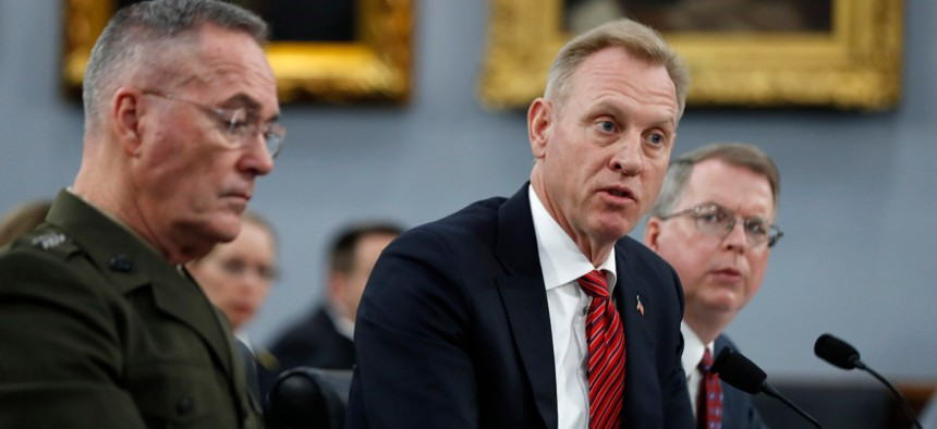 Joint Chiefs of Staff Chairman Gen. Joseph Dunford, left, acting Defense Secretary Patrick Shanahan, and Acting Deputy Secretary of Defense David Norquist, testify to a House Appropriations subcommittee on budget hearing in May.