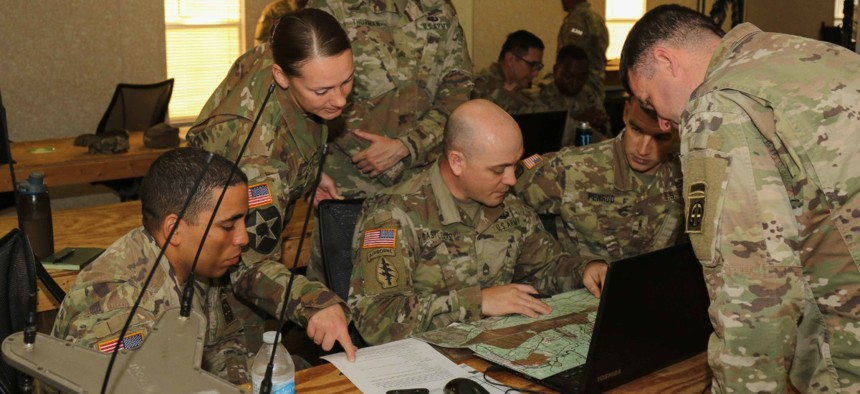 Army paratroopers participate in pre-mission planning during the Electronic Warfare competition at Fort Bragg, North Carolina, in May.