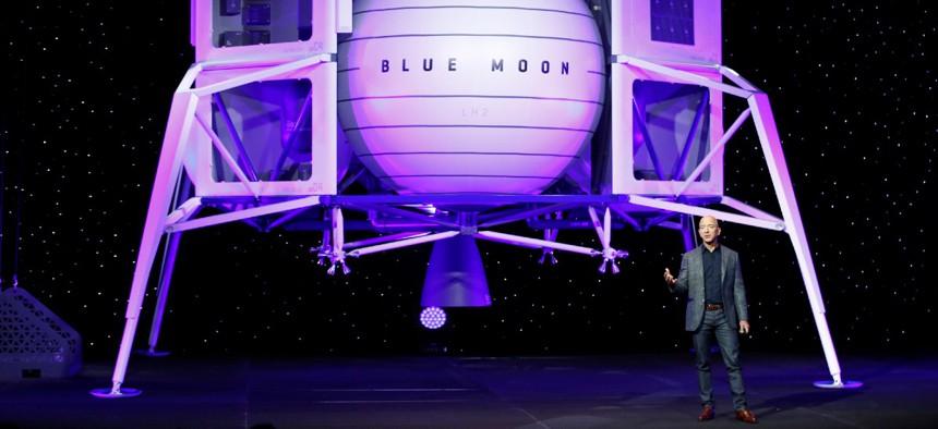 In May, Jeff Bezos speaks in front of a model of Blue Origin's Blue Moon lunar lander in Washington.