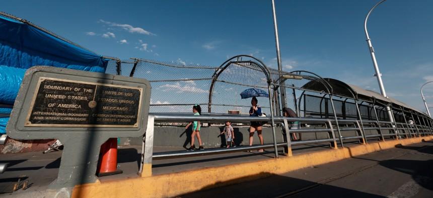 Pedestrians walk to El Paso, Texas, as they cross the Paso del Norte International Bridge, from Ciudad Juarez, Mexico, Aug. 6, 2019.