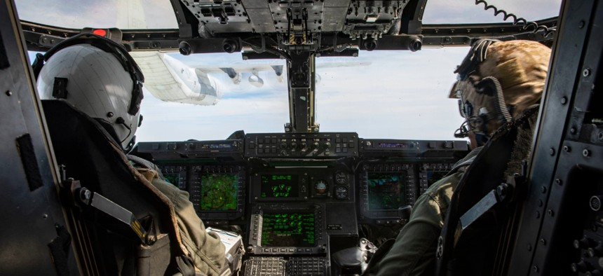 A MV-22B Osprey with Medium Tiltrotor Squadron VMM-263 prepares to receive fuel from a KC-130J Super Hercules from Marine Aerial Refueler Transportation Squadron 252 over the Atlantic Feb. 12, 2020.