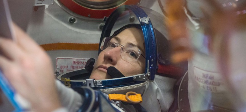 At the Baikonur Cosmodrome in Kazakhstan, NASA astronaut Christina Koch works inside the Soyuz MS-12 spacecraft Feb. 27 during pre-launch training.