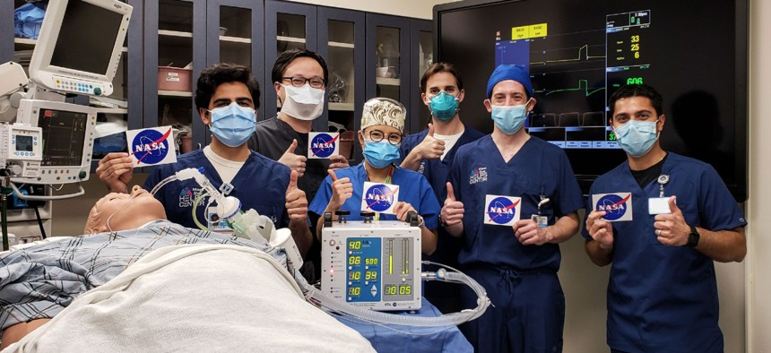 At left, doctors at the Icahn School of Medicine at Mount Sinai in New York City give a thumbs up after testing a ventilator prototype developed by NASA's Jet Propulsion Laboratory in Southern California.